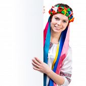 picture of national costume  - happy  young women  in the Ukrainian national costume behind white board - JPG
