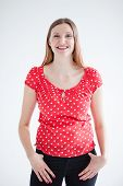 picture of woman red blouse  - Studio portrait of happy smiling attractive woman wearing red blouse and standing with hands on hips - JPG