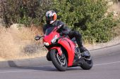 stock photo of crotch-rocket  - Red Motorcycle Sport Bike speeding through a corner in the Mountains - JPG