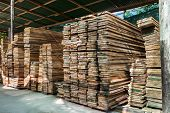 image of lumber  - stack of pile wood bar in lumber yard factory use for construction wood industry - JPG