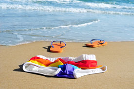 stock photo of naturist  - rainbow swimsuit and orange flip - JPG