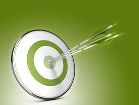 image of objectives  - Three arrows hitting the center of a target over green background - JPG