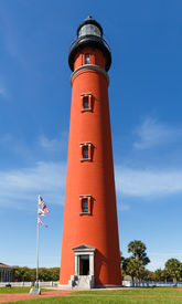 stock photo of inlet  - Thebrilliant red lighthouse at Florida