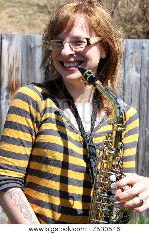 Woman Plays Saxophone Outdoors