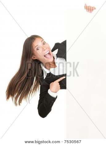 Excited Woman Pointing At Sign