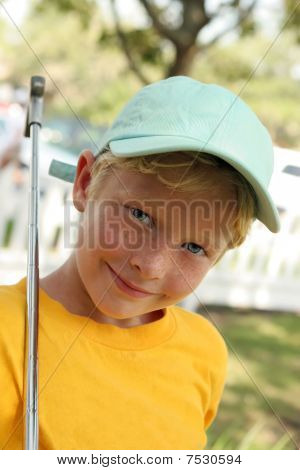 Boy Plays Golf In Blue Cap