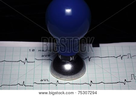 Cardiology, Healthcare Concept. Ecg And A Metal Electrode.