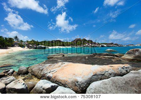 Stunning beach with white sand, unique huge granite boulders, turquoise ocean water and blue sky at Virgin Gorda, British Virgin Islands in Caribbean