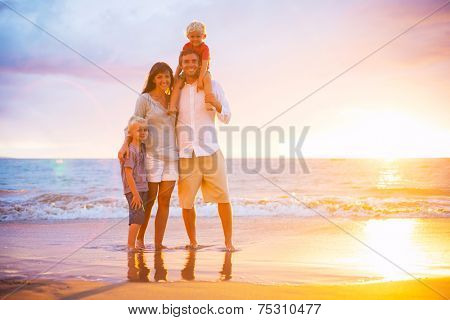 Portrait of Happy Young Family at Sunset