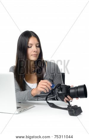 Female Photographer Inserting A Card In Her Camera