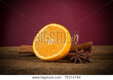 Orange Fruit, Cinnamon Sticks And Anise Stars