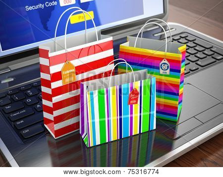 E-commerce concept. Colourful paper striped shopping bags on laptop keyboard. 3d