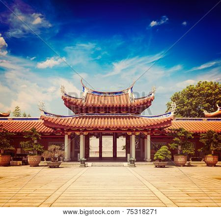 Vintage retro effect filtered hipster style travel image of gates of Lian Shan Shuang Lin Monastery, Singapore