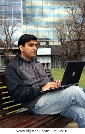 Indian Student Working On His Laptop.