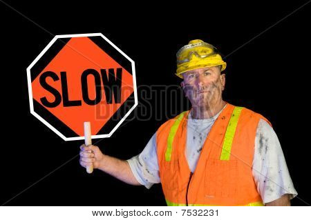 Dirty Construction Worker Holding Slow Sign