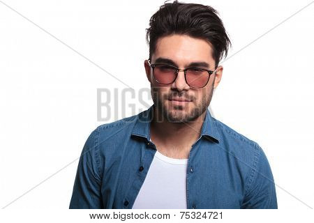 Close up portrait of a attractive young man looking at the camera