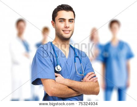 Confident doctor in front of his medical team