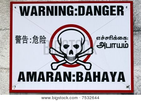 Warning in four languages