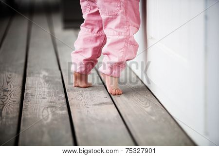 Little girl reaching up