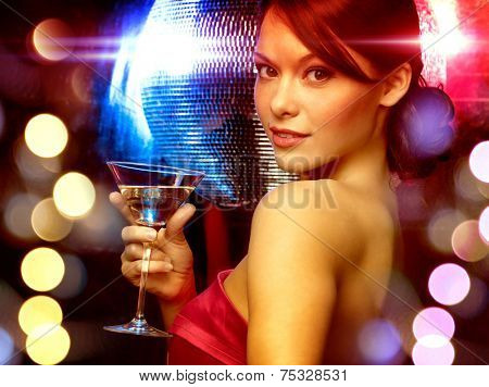 luxury, vip, nightlife, party concept - beautiful woman in evening dress with cocktail and disco ball