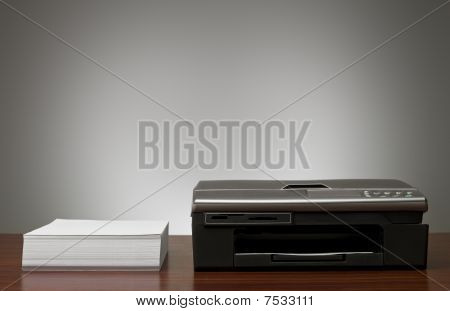 Copy Machine And A Pile Of Papers