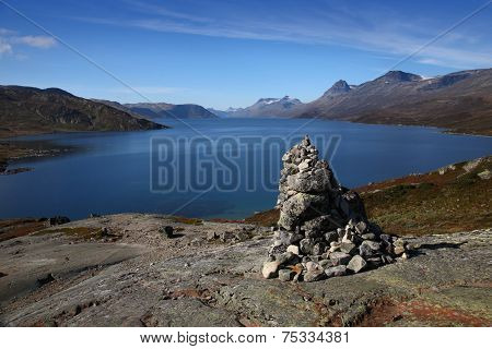 Scenic view of the Bygdin Lake with a cairn on a trekking route in Jotunheim Mountains, Norway