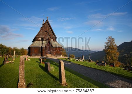 Traditional Norwegian church in Reinli, stave church type, Sør-Aurdal, Norway, on a bright sky