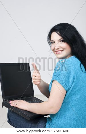 Happy Woman On Floor With Laptop Give Thumbs