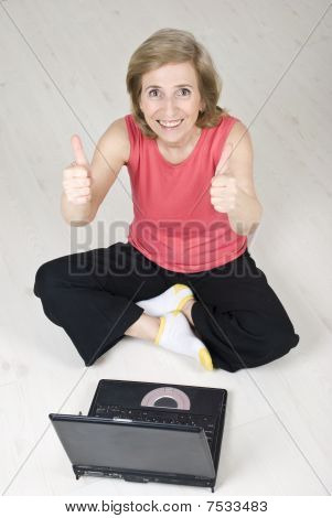 Senior Woman Giving  Thumbs Up Using Laptop