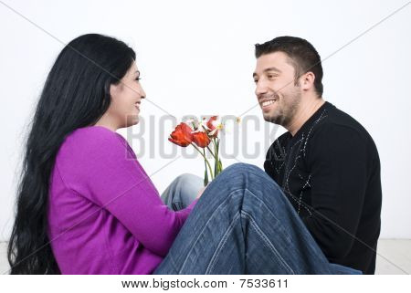 Couple Sitting On Floor And Laughing