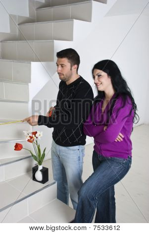 Couple  Planning In New House