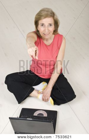 Senior Woman With Laptop Pointing