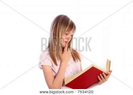 A Pensive Blond Girl With A Red Book