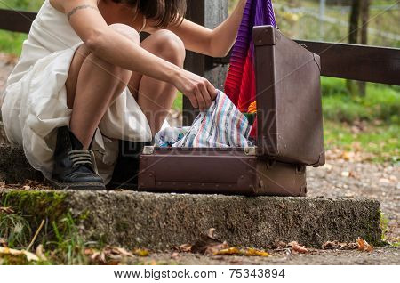 Girl Looks For The Clothes Inside Her Suitcase