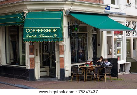 AMSTERDAM - AUGUST 26: Coffeeshop exterior at daytime on August 26, 2014 in Amsterdam.