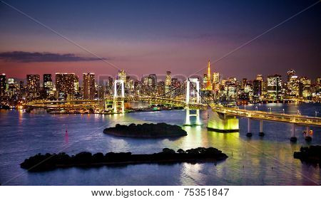 Rainbow Bridge and Sumida River in Tokyo, Japan. Night photo.
