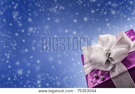 Christmas or Valentine s purple gift with silver ribbon abstract blue background