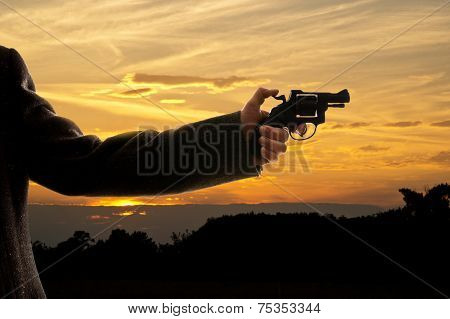 Silhoutte Of A Man With A Handgun