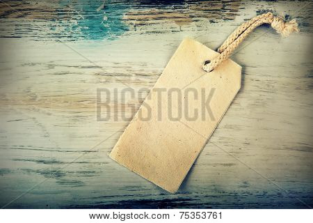 Canvas price tag with old wooden background.