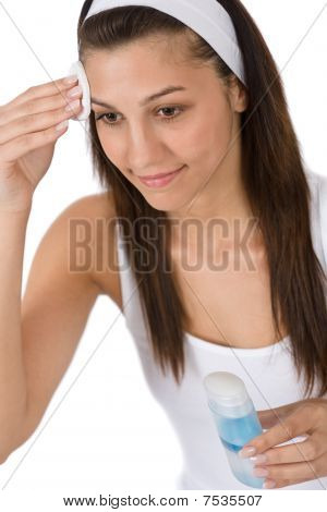 Beauty Facial Care - Teenager Woman Cleaning Acne Skin