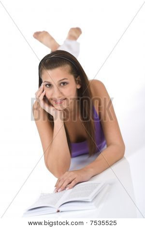 Happy Teenager Woman With Book Lying Down