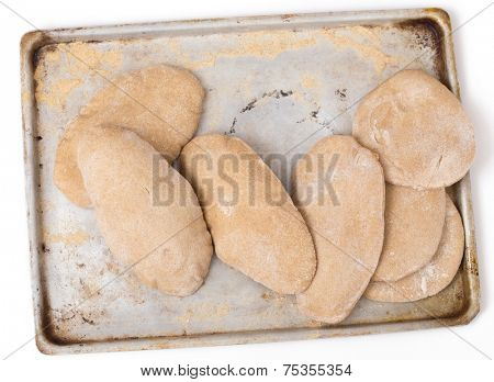 Loaves of traditional Egyptian homemade brown pita bread, fresh from the oven. called aish baladi