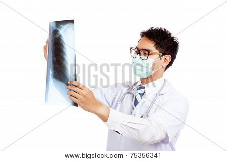 Asian Male Doctor Wear Mask Look At X-ray Film