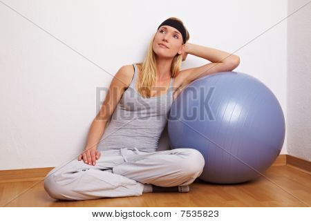 Woman Leaning On Gymn Ball
