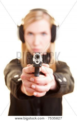 Woman With Pistol And Ear Protection