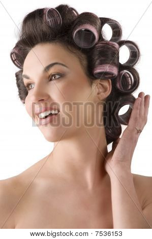 Woman Smiling With Hair Rollers