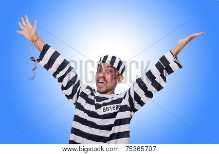 Badly bruised prisoner with handcuffs