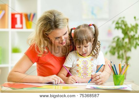 mother and her child pencil together