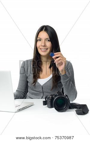 Female Photographer Showing Sd Card With Her Pictures