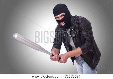 Male hooligan with bat on white
